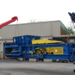 Hauling-a-Two-Ram-Baler-for-installation-1