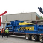 Hauling-a-Two-Ram-Baler-for-installation-2
