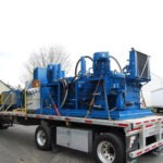 Hauling-a-Two-Ram-Baler-for-installation-3